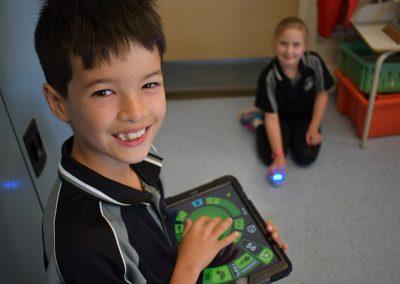 students using robot ball